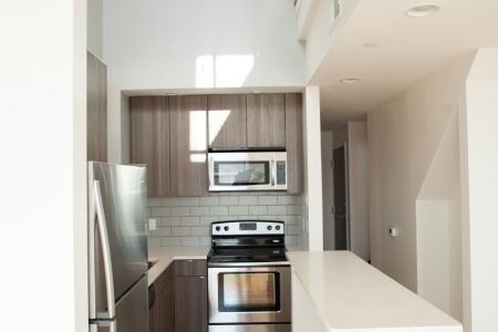 Galley kitchen and open floor design of Broadway Square renovation