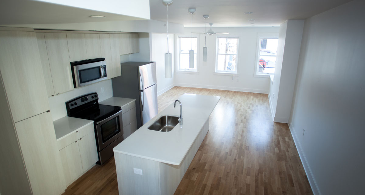 Open floor plan of Broadway Square kitchen and living area
