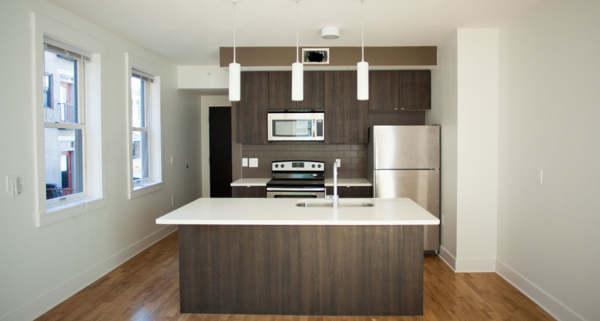 Kitchen and Island of renovated Broadway Square