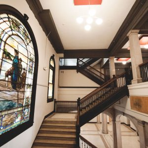 Renovated main foyer stairwell of Alumni Lofts