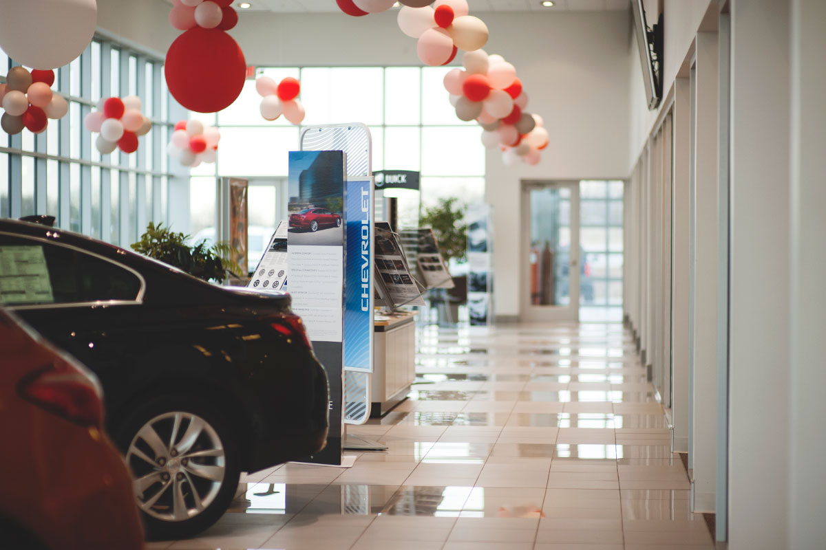 Auto showroom with cars and balloons at Piles Chevrolet