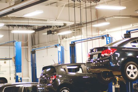 Cars in the bays of the garage/shop at Piles Chevrolet