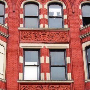 Bright red brick facade of Trevarren Flats